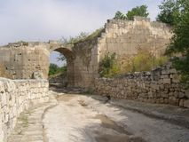 The ancient gate of Horta-Kapu Northern gate, Chufut-Kale fortress. Crimea Stock Image