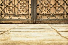 Ancient gate and lattice of sepia color Royalty Free Stock Photo