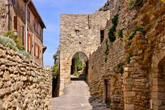 Ancient gate in the medieval walls of Saignon, Provence, France Stock Image