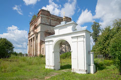 Ancient gate rural churchyard in the background of the abandoned Cathedral of St. Nicholas Royalty Free Stock Images