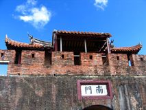 Ancient Gate to a Chinese City. The characters above the arch mean South Gate Royalty Free Stock Photo