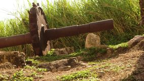 Ancient gear wheel sitting next to 18th century aqueduct Montego Bay, Jamaica. Aqueduct gear wheel located on a legendary 18th-century sugar plantation in stock video footage