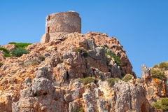 Ancient Genoese tower on Capo Rosso, Corsica Royalty Free Stock Image