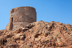 Ancient Genoese tower on Capo Rosso, Piana. Region, Corsica island, France royalty free stock photo