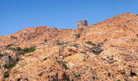 Ancient Genoese tower, Corsica island, France. Ancient Genoese tower on the top of Capo Rosso. Piana region, Corsica island, France Stock Image