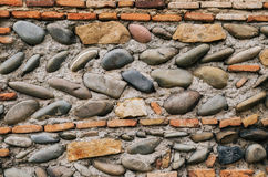 Ancient georgian natural stone wall of different sizes and brick Stock Images