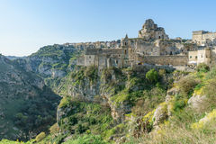 Ancient ghost town of Matera Sassi di Matera in beautiful sun. Shine with blue sky, southern Italy Stock Photos