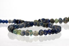 Ancient glass beads. On white background Stock Photos