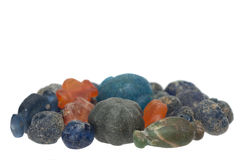 Ancient glass beads. On white background Royalty Free Stock Images