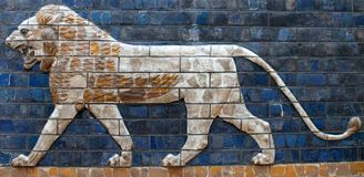 Ancient relief with Lion from the Babylonian Ischtar Tor royalty free stock images
