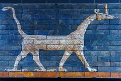Ancient glazed brick panel with Sirrush from the Babylonian Ischtar Tor royalty free stock photography