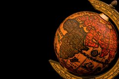 Ancient globe replica with map of Asia, Europe, Africa and Indian Ocean and during the Age of Discovery on black background with. Copy space stock images