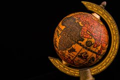Ancient globe with Asia, Africa, Europe and Indian Ocean. Ancient globe replica with map of Asia, Europe, Africa and Indian Ocean and during the Age of Discovery stock image