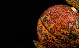 Ancient globe replica with map of East Asia countries on Eastern Hemisphere during the Age of Discovery on black background with. Copy space royalty free stock photo
