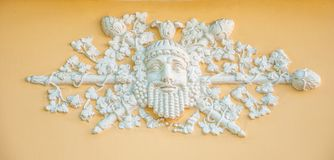 The ancient god of winemaking Dionysus Bacchus, Bacchus. Ancient bas-relief depicting the ancient god of winemaking Dionysus Bacchus, Bacchus adorns the facade Royalty Free Stock Images