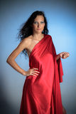 Ancient goddess in red satin on Royalty Free Stock Photography