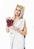 Ancient godness with a bunch of grapes on white Royalty Free Stock Images