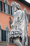 Ancient gods with grapes and horn of plenty. `Autumn` by Giovanni Caccini, 1608, is a statue placed at the beginning of the bridge of Santa Trinita, in Florence Stock Photos