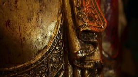 Ancient gold buddhist scuplture stock video footage