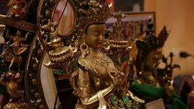Ancient gold buddhist scuplture stock footage