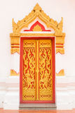 Ancient Gold carving wooden door of Thai temple Stock Images