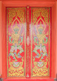 Ancient Gold carving wooden door of Thai temple Royalty Free Stock Photography