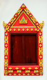 Ancient Gold carving wooden window of asia temple Stock Photography
