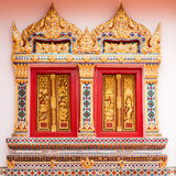 Ancient Gold carving wooden window of Thai temple Stock Photos