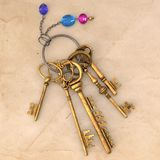 Ancient gold keys on a charm with a chain and precious stones. The image size is 4096x4096 pixels. This image is a 3D model rendering stock illustration