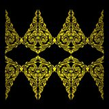 Ancient Gold Thailand pattern,on black wall Stock Photography