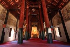 Ancient golden Buddha inside Thai temple Stock Photos