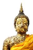 Ancient golden Buddha isolated. White background stock images