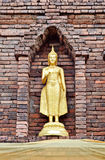Ancient golden Buddha's staue with brick pogoda Stock Photos