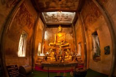 Ancient golden buddha in Thai church. Royalty Free Stock Photos