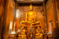 Ancient golden buddha in Thai church. Royalty Free Stock Image