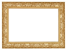 Ancient golden carved wide wooden picture frame. With cut out canvas isolated on white background Stock Photos