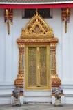 Ancient Golden carving door. Royalty Free Stock Image