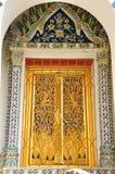 Ancient Golden carving door. Stock Image