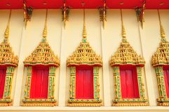 Ancient Golden carving wooden door of Thai temple in Bangkok, Th Stock Photography
