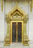 Ancient Golden carving wooden door of Thai temple. In Bangkok, Thailand Royalty Free Stock Images