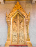 Ancient Golden carving wooden door Stock Images
