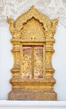 Ancient Golden carving wooden window Stock Photography
