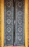 Ancient golden carving wooden window Stock Photos