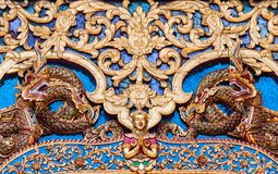 Ancient golden carving wooden window of Thai temple. Thailand Stock Images