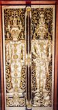 Ancient golden carving wooden window of Thai temple. Thailand Royalty Free Stock Image