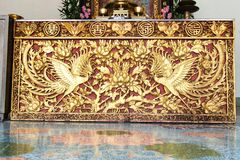 Ancient golden Chinese temple scuplture. With symbolic pattern Stock Images