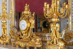Ancient golden clock in the Hermitage Royalty Free Stock Images