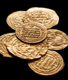 Ancient golden islamic coins with arabic letters Royalty Free Stock Photography