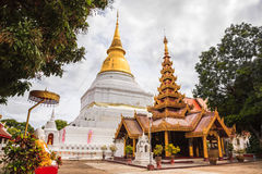 Ancient golden pagoda and myanmar style viharn Stock Photography