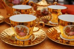 Ancient golden porcelain cups coffe or tea Stock Image